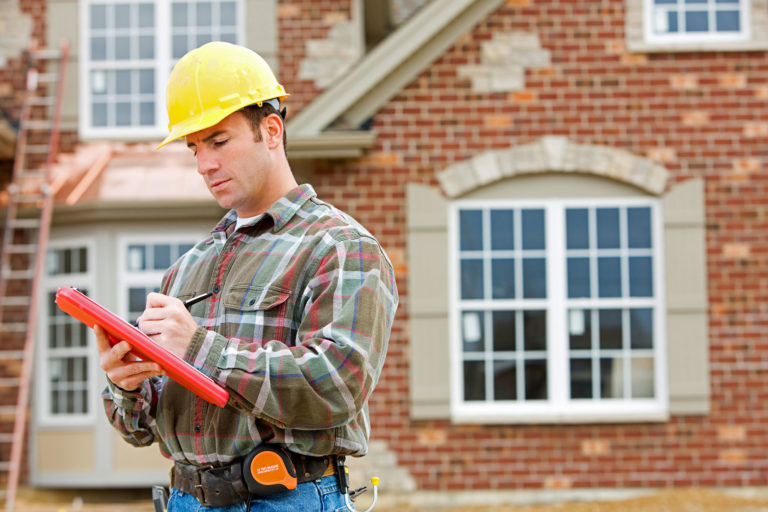 Construction Worker Assessing Risk