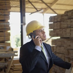 Contractor on phone in lumber yard