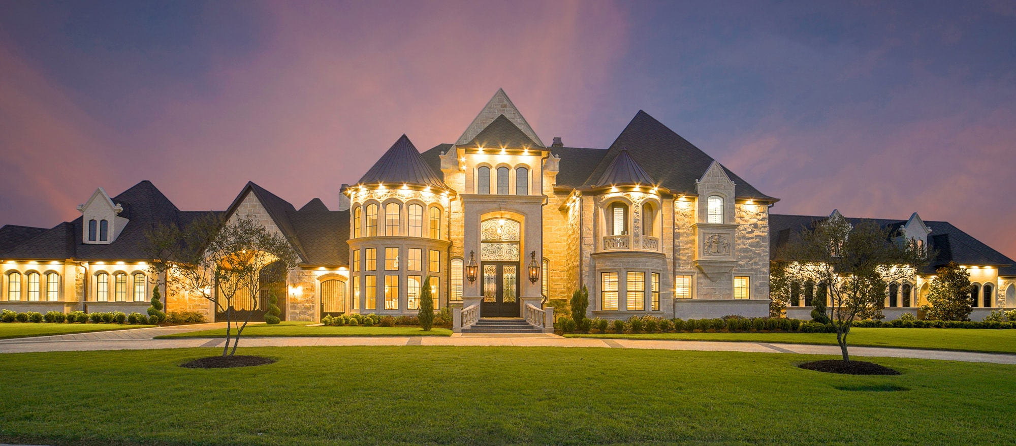 Well-lit mansion at twilight