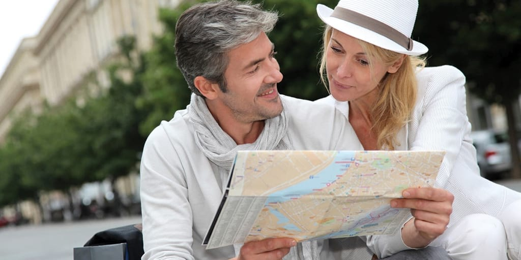A man and woman looking at a paper map