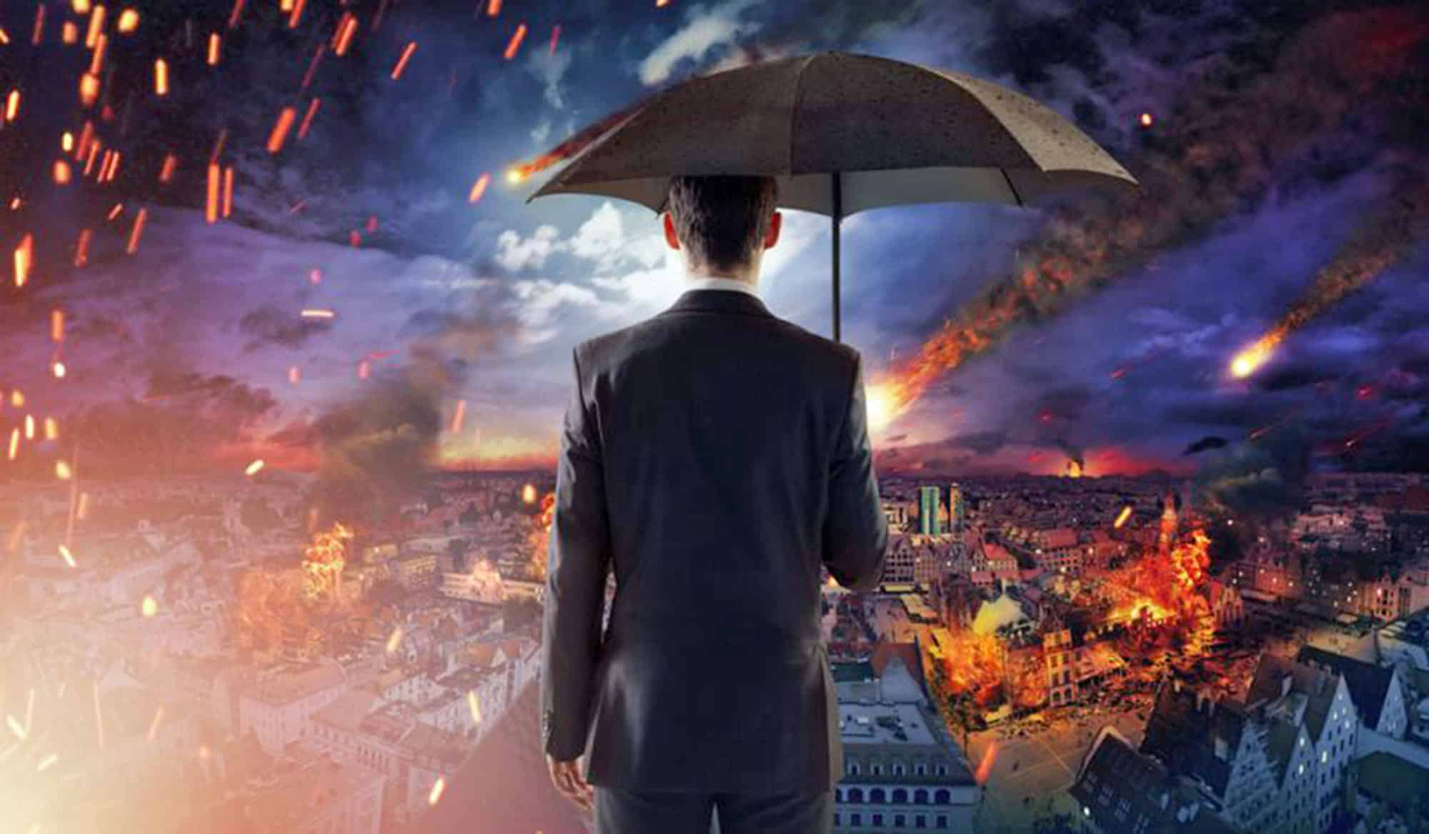 A man in a suit holding an umbrella and watching meteorites crash into a city